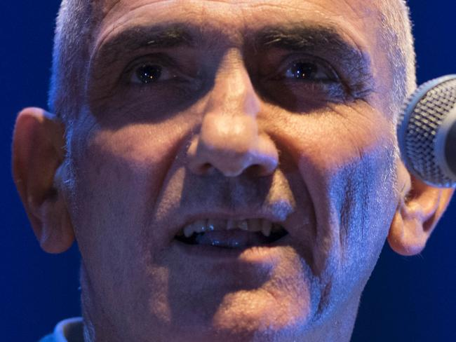 Paul Kelly Live at the Opera House Forecourt. Under stormy clouds people dressed in their clear ponchos they waited for Paul Kelly's magic. Picture's darren leigh roberts