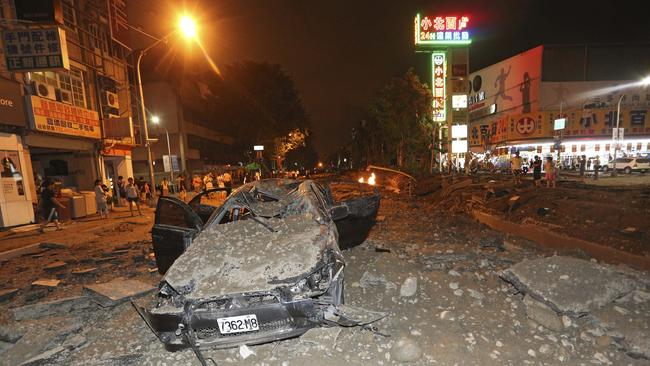 Destroyed ... a crushed vehicle sits in rubble after multiple explosions from an underground gas leak in Kaohsiung, Taiwan.