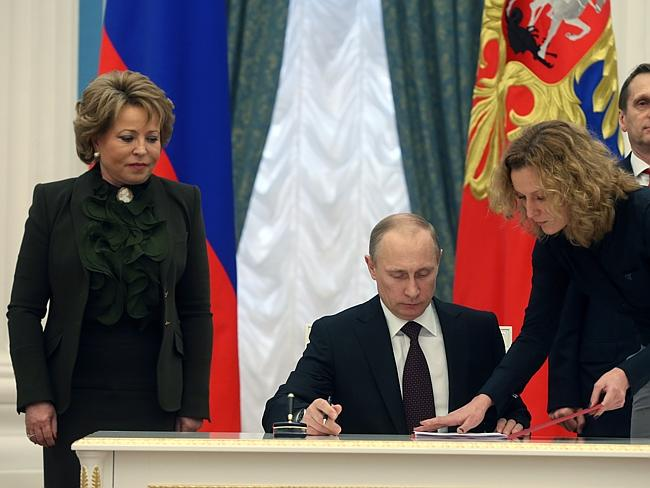 Annexation ... Russian President Vladimir Putin signs bills making Crimea part of Russia