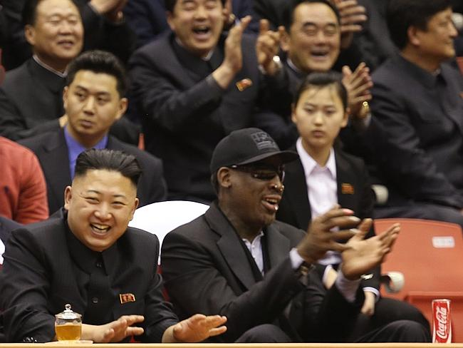 North Korean dictator Kim Jong Un, left, and former NBA star Dennis Rodman watch North Korean and U.S. players in an exhibition basketball game at an arena in Pyongyang, North Korea.