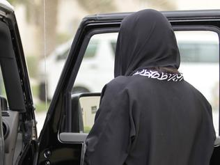 A woman gets into a car in Riyadh, Saudi Arabia, Tuesday, May 24, 2011. A Saudi woman was arrested for a second time for driving her car in what women's activists said Monday was a move by the rulers of the ultraconservative kingdom to suppress an Internet campaign encouraging women to defy a ban on female driving. Manal al-Sherif and a group of other women started a Facebook page called 'Teach me how to drive so I can protect myself,' urging authorities to lift the ban and posted a video clip last week of al-Sherif behind the wheel in the eastern city of Khobar. The page was removed after more than 12,000 people indicated their support for its call for women drivers to take to the streets in a mass drive on June 17. (AP Photo/Hassan Ammar)