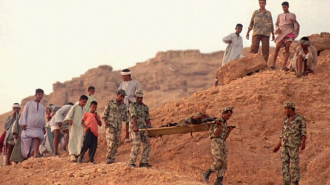 Terrorist attack ... Egyptian soldiers carry the body of one of the suspected Islamist militants involved in the 1997 Luxor massacre.