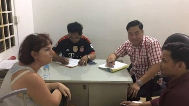 Tammy Davis-Charles is questioned by Cambodian Police who allege she falsified birth certificates in her surrogacy business. Picture: Cambodian National Police.