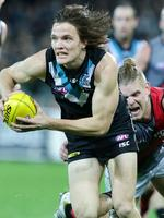 Round 16: Jared Polec breaks away against Essendon at Adelaide Oval. Picture: Sarah Reed.