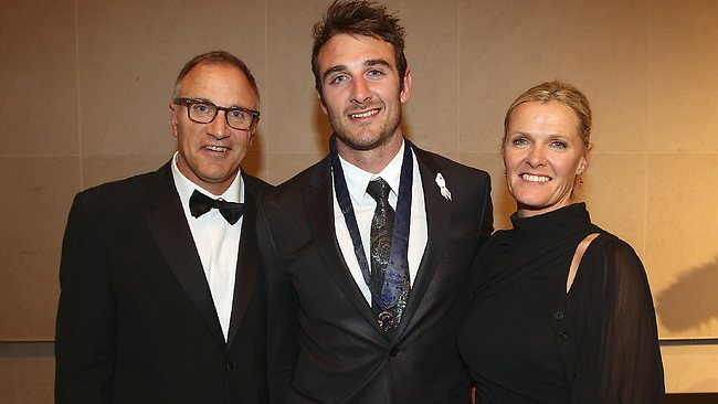 Jobe Watson with his dad Tim and mum Susie after winning last year's Brownlow Medal. Picture: George Salpigtidis