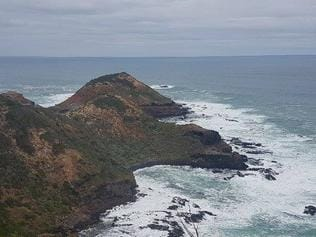 A man is fighting for life after being swept off rocks at Cape Schanck on the Mornington Peninsula. Picture: John Remington