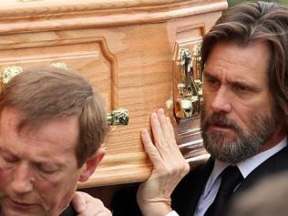 Jim Carrey carries the coffin of ex girlfriend Cathriona White. Picture: Splash