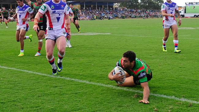 Alex Johnston scores a try during the Rabitohs' round 21 clash with Knights