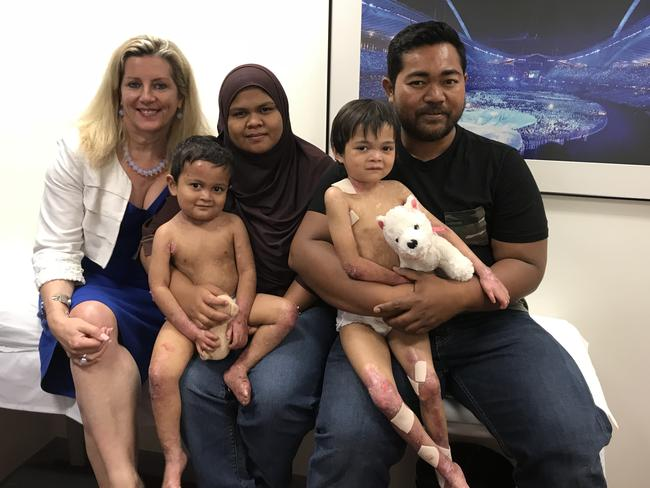 Professor Dedee Murrell, of Premier Specialists in Sydney, with Mohammed, three, and Siddiqah, five, and their mum and dad, Ida and Aiman.
