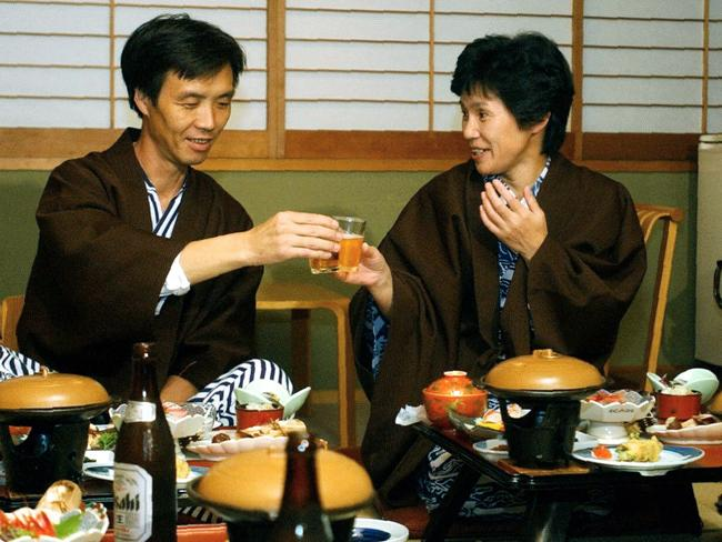 New life ... Abductees Kaoru Hasuike, 45, left, and his wife Yukiko Okudo, 46, toast before dining a course of Japanese cuisine at a hot spring resort inn in Myokokogen, Japan. Picture: Supplied