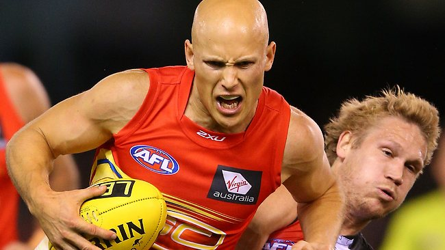 The Suns' Gary Ablett wins the contest for the ball against St Kilda's Sam Gilbert. Picture: Getty Images