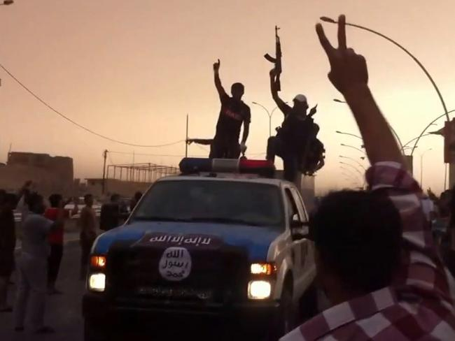 Victory parade ... An image taken from a video uploaded on Youtube purporting to show Islamic State of Iraq and Syria (ISIS) militants in the northern city of Mosul. Former UK President Tony Blair insists the uprising does not in any way strengthen criticism of his support for the controversial 2003 invasion.