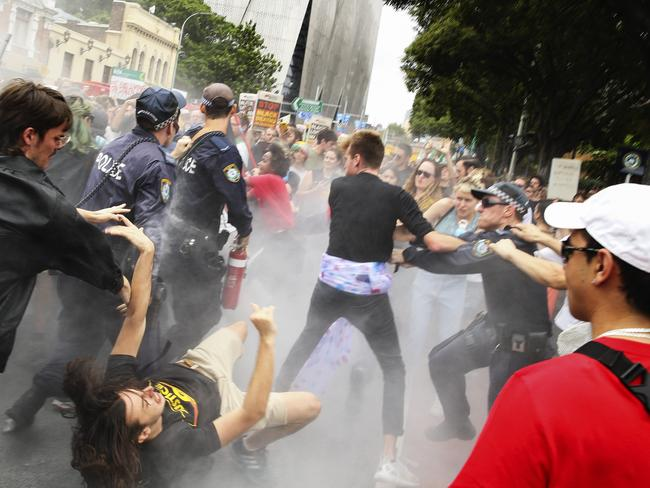 Police shoved demonstrators to the ground as chaos broke out at the Sydney march this afternoon. Picture: Justin Lloyd