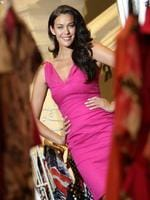 <p>Hot stuff ... Megan Gale dressed in a hot pink outfit from David Jones in Sydney, ahead of the National Breast Cancer Foundation Donation Day in 2009.</p>