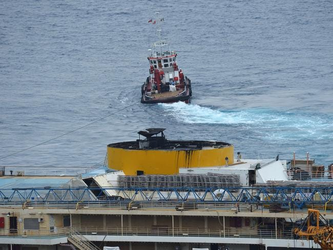 Big job ... a tug boat pulls the wreck of the  <i>Costa Concordia </i>cruise ship during an operation to refloat the boat, two-and-a-half years after it crashed off the island of Giglio in a night-time disaster.