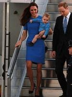 Catherine, Duchess of Cambridge, wears a blue Stella McCartney dress as she, Prince William, Duke of Cambridge and their son Prince George of Cambridge arrive at Fairbairn Airport in Canberra, Australia. Picture: Getty