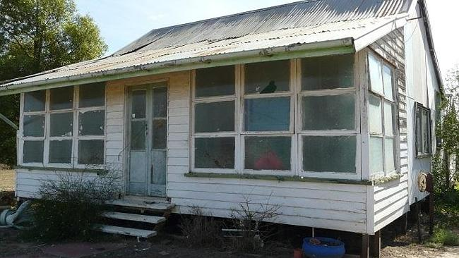 A renovators delight at 113 Mary St, Mitchell is being marketed for $45,000. Supplied: re