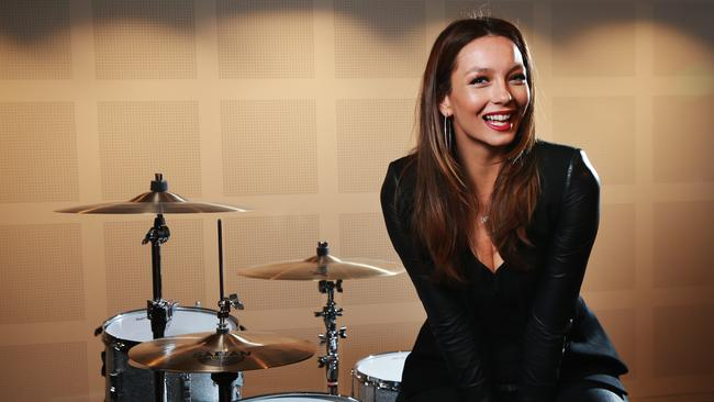 Happy days ... Singer Ricki-Lee Coulter has won the support of radio for new single. Picture: Toby Zerna
