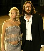 <p>Actor Kate Hudson & her husband Chris Robinson</p>