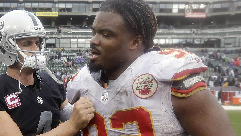 Oakland Raiders quarterback Derek Carr greets Kansas City Chiefs nose tackle Dontari Poe.