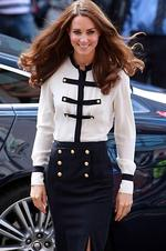 <p>The Duchess of Cambridge arrives at the Machan Express Coffee bar, Birmingham, in a sailor-inspired skirt and blouse.  Photo: David Jones, AFP</p>