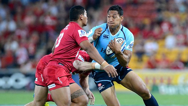 Waratahs fullback Israel Folau is confronted by the Reds defence at Suncorp Stadium. Picture: Bradley Kanaris