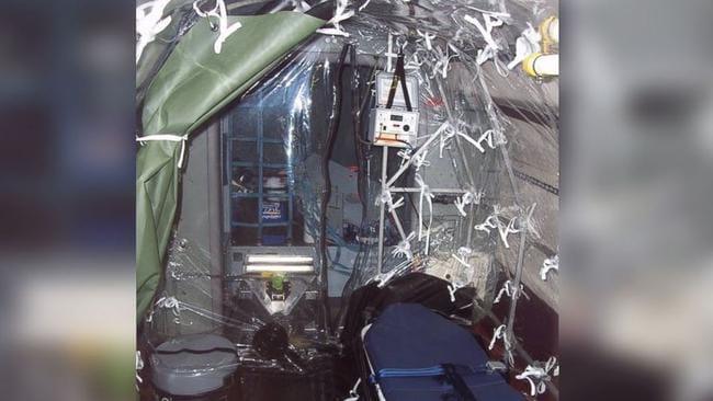 Plastic tent ... the patient will be flown back to the US in a mobile isolation ward.