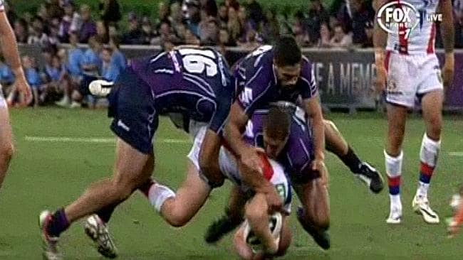 Alex McKinnon falls awkwardly in this tackle that left him with a fractured neck.