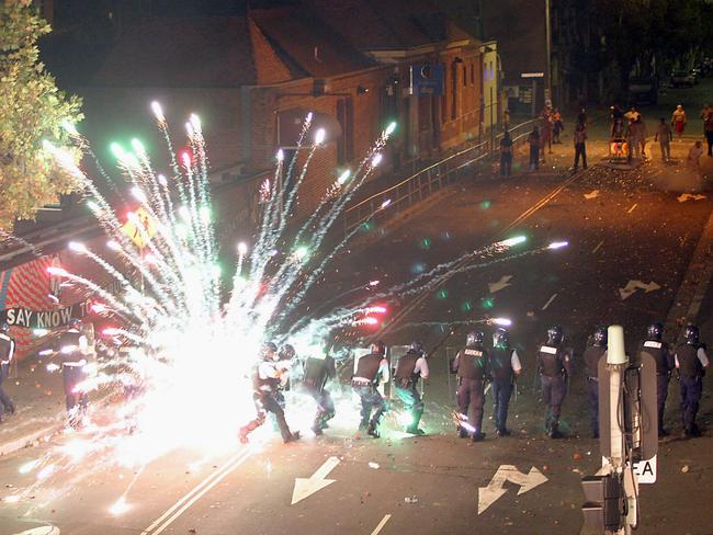 Youths hurl fireworks at riot police and firemen in Redfern.