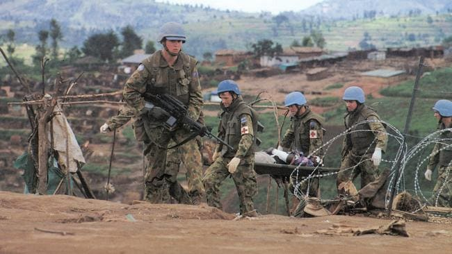UN soldiers tend to the wounded. Picture: George Gittoes