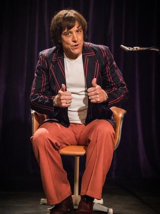 Samuel Johnson with wig, no hat as Molly Meldrum in Molly.