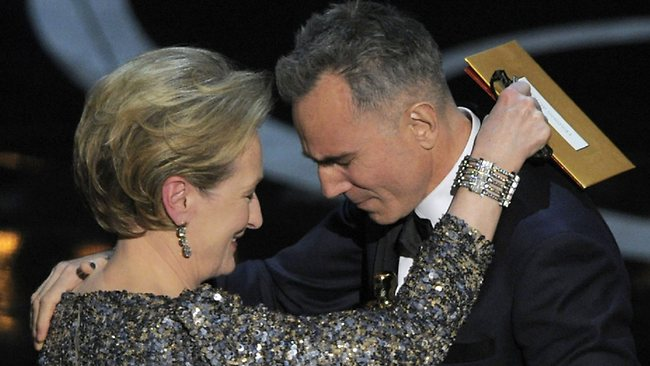 Meryl Streep, left, presents the award for best actor in a leading role to Daniel Day-Lewis for Lincoln. Picture: AP