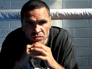 ANTHONY MUNDINE IN THE POOL