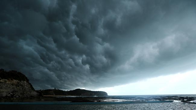 A distinctive shelf cloud, with a similar shape to a derecho, passing over Sydney. Picture: John Grainger