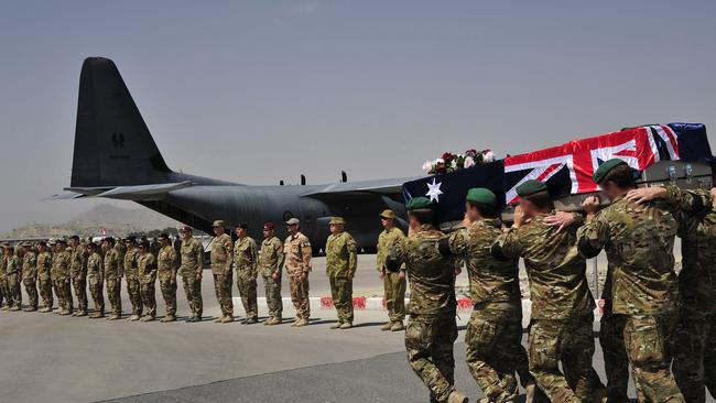 The bearer party carry the casket of Lance Corporal Todd Chidgey from the Coalition Hospital at Kabul International Airport to the waiting Royal Australian Air Force C-130J Hercules aircraft.