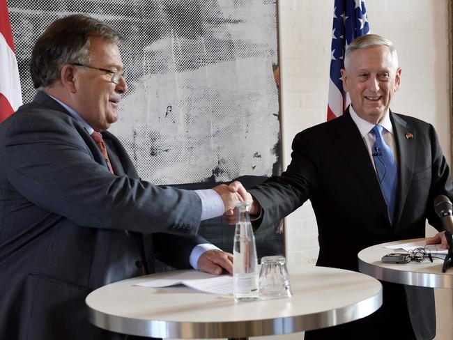 US Secretary of Defence Jim Mattis, right, shakes hands with Danish Defence Minister Claus Hjort Frederiksen. Picture: AP