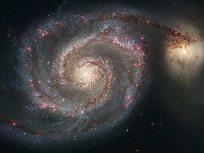 The graceful, winding arms of the majestic spiral galaxy M51 (NGC 5194) appear like a grand spiral staircase sweeping through...