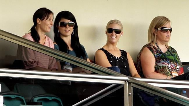 Wives and girlfriends watch on at a cricket match. L-R: Nathan Hauritz's wife, Dianne, Mitchell Johnson's partner, Jessica Bratich and Peter Siddle's partner, Katrina Quaine.