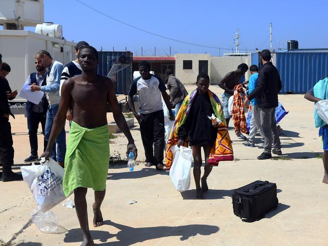 African migrants, whose boat sank off the Libyan coast, receive food and medical care at the Tripoli port. Picture: AFP/Mahmud Turkia