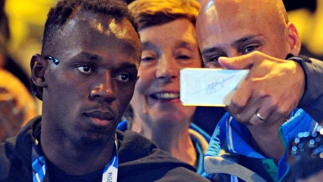 Jamaican sprinter Usain Bolt is used to posing for pictures with fans at the Glasgow Commonwealth Games.