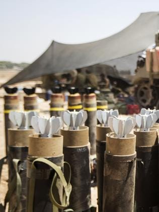 Munitions ... mortars are stored at an army staging area along Israel's border with the Gaza Strip. Picture: Jack Guez