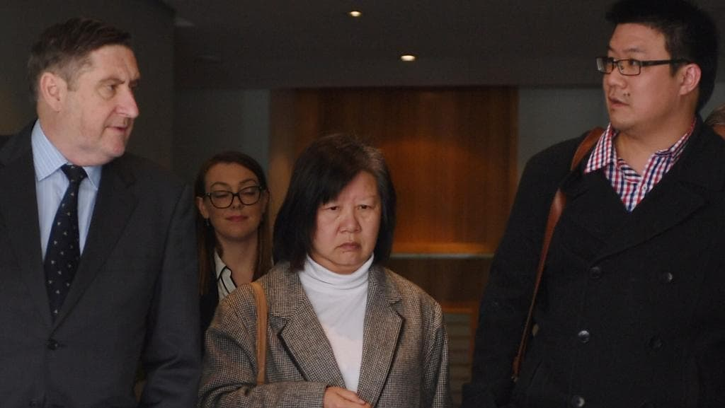 The family of Samuel Seeto and their lawyer (left) of leave the Glebe State Coroners Court in Sydney. Picture: AAP