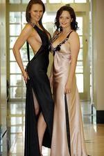 Football WAGS Melinda Lloyd and Deanne Woewodin show off their Ruth Tarvydas designs ahead of the Brownlow. Picture: Richard Hatherly