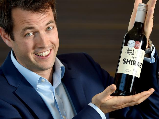 Ed Ashley, the head of wine sourcing at Liquorland, holding one of their award-winning wines. Picture: Sam Wundke