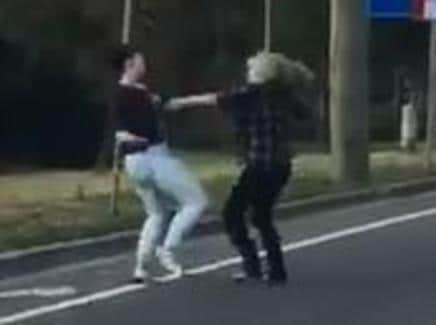 Footage of two girls fighting on the side of the road in Penrith has emerged on Facebook. Picture: Facebook / Khan Evan