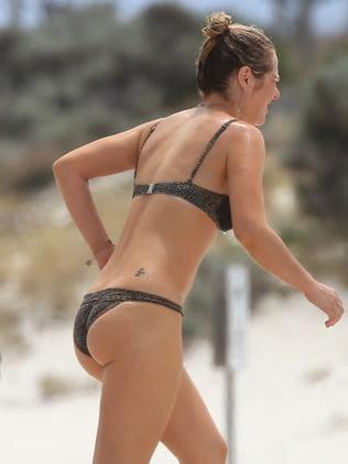 Jess Marais darts across the sand.