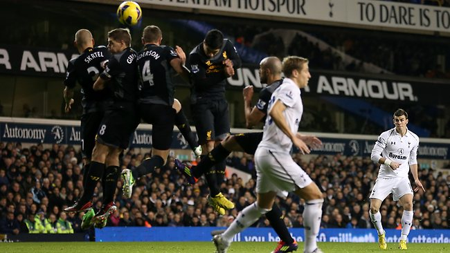 Gareth Bale of Tottenham Hotspur scores their second goal from a free kick in the Premier League match against Liverpool at White Hart Lane. Picture: Julian Finney