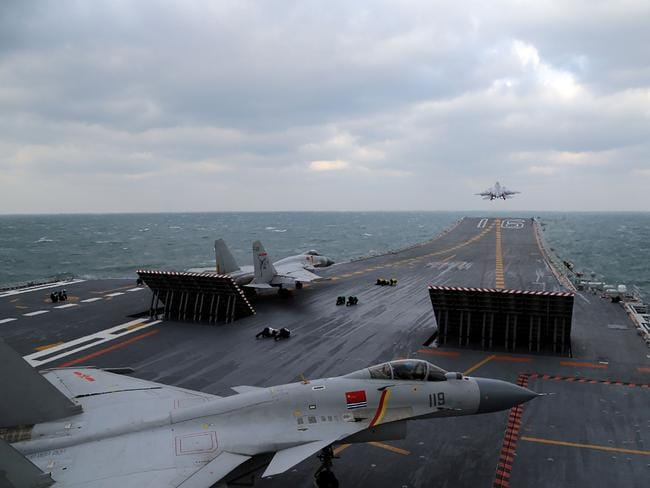 Chinese J-15 fighter jets being launched from the deck of the Liaoning aircraft carrier as it and a flotilla of other warships passed south of Taiwan. Picture: AFP