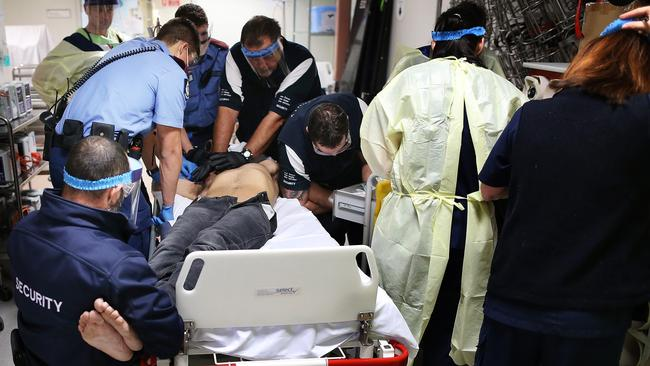 Nine medical staff and security try to control an ice addict in a state of psychosis in the Emergency Department of Royal Perth Hospital. Picture: Gary Ramage