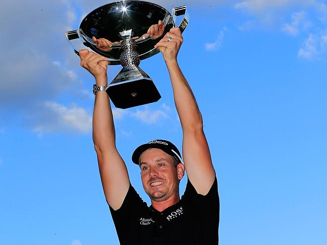 Henrik Stenson poses with the FedEx Cup after winning the TOUR Championship and the FedEx Cup playoffs.